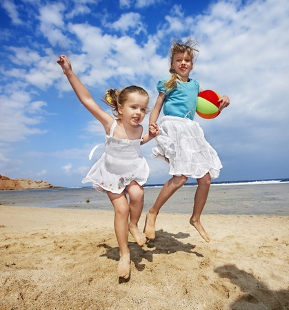 Little girl  playing on  beach with ball. Stock Photo - 8942421