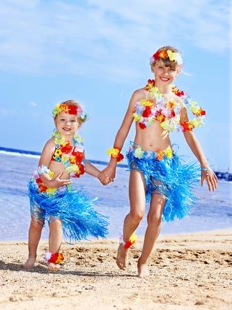 Little girl  playing on  Hawaii beach . photo