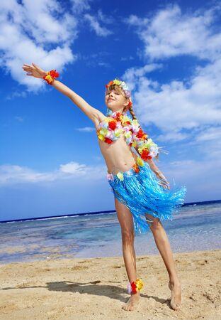 Little girl  playing on  Hawaii beach . Stock Photo