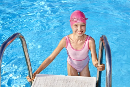 wetsuit: Little girl  swimming in pool. Stock Photo