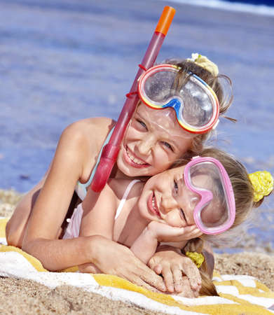 Children playing on  beach. Snorkeling. photo