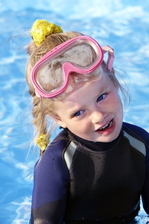Child in swimming pool learning snorkeling. Sport. photo