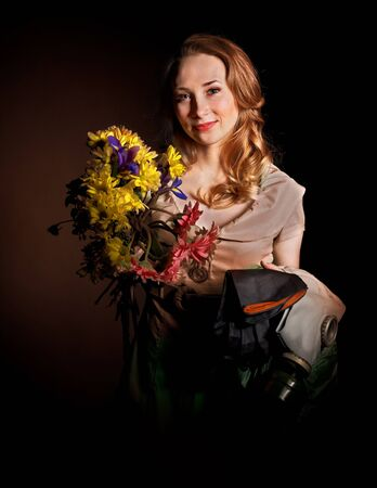 Young woman holding flowers and gas mask . Stock Photo - 8942254