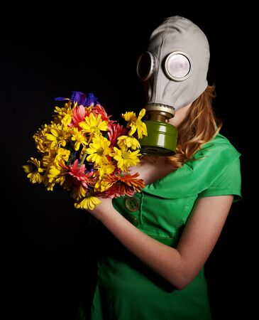 Young woman  in gas mask and flowers .Toxic Environment Stock Photo - 8942325