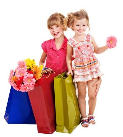 ni�os rubios: Ni�a feliz con bolsa de compras. Aislado.