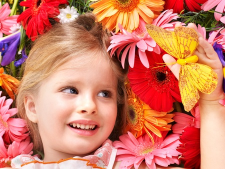 Little cute girl lying on the flower. photo