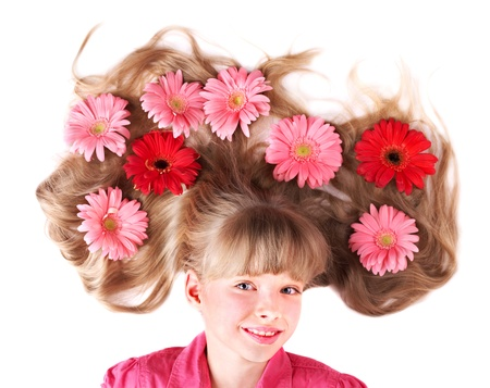 long shot: Little cute girl lying  on the flowers. Spring hairstyle.