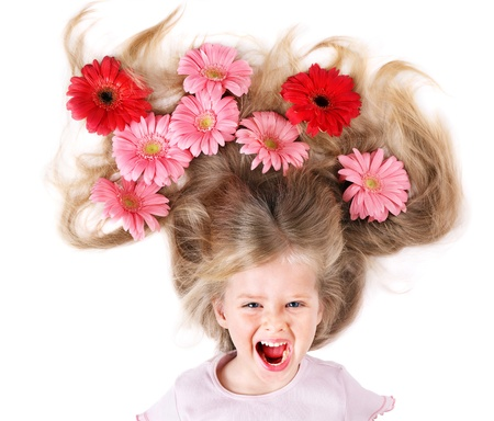 Little cute girl with long hair and flowers. Spring hairstyle. photo