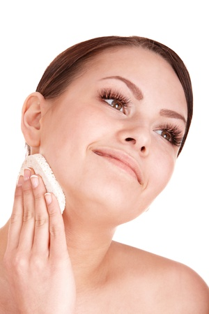 Young woman washing her face by sponge. Isolated. Stock Photo - 9093867