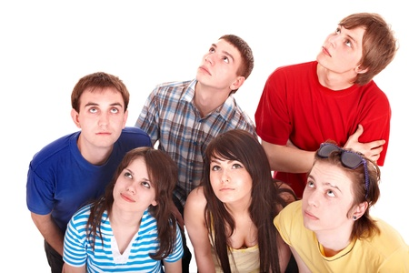 Group of young people looking up. photo