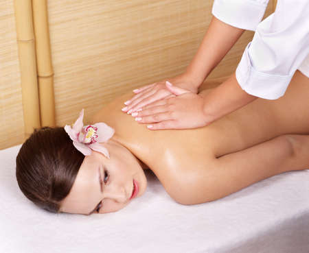 Young beautiful woman on massage table in beauty spa.  Series. Stock Photo - 9093786