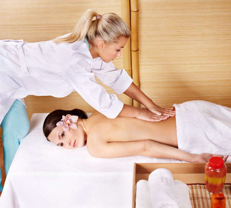 Young beautiful woman on massage table in beauty spa.  Series. Stock Photo - 9094123