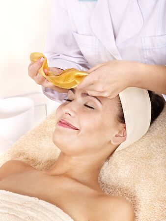 Young woman with gold facial mask. Stock Photo - 9784452