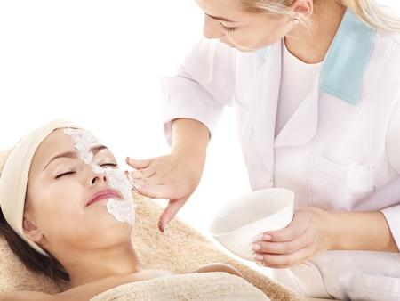 beautician: Beautician applying  facial mask by young woman.