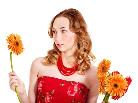 Worried young woman holding flowers. photo