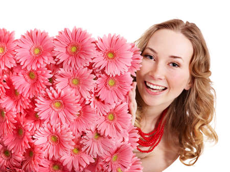 Happy young woman holding  flowers. Isolated. photo