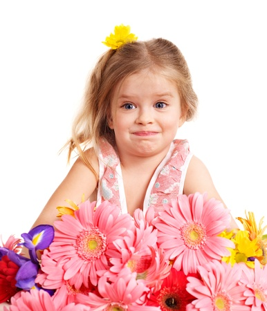 Surprised child holding flowers. Isolated. photo