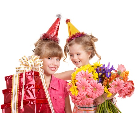 Little girl in party hat with stack gift box. Isolated. photo