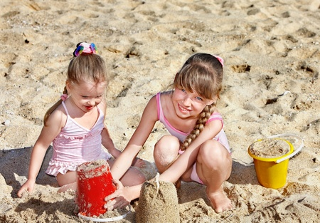 bucket and spade: Little girl  playing in sand.