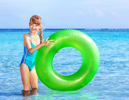 Children holding inflatable ring in sea. Stock Photo - 9268073