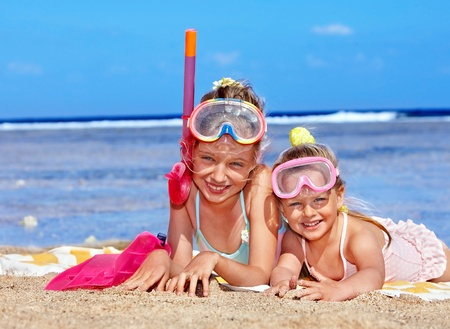 Children playing on  beach. Snorkeling. Stock Photo - 9268180