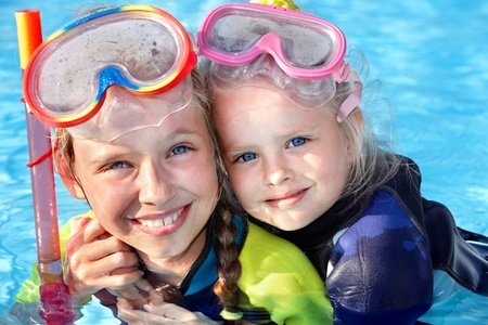 swim mask: Children in swimming pool learning snorkeling. Sport. Stock Photo