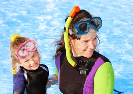 Child with mother in swimming pool learning snorkeling. Stock Photo - 9284298