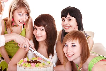 Group of happy young people with cake. Isolated. photo