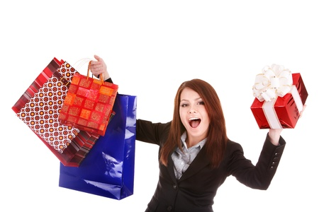 Young woman holding  shopping bag and gift box. Isolated. photo