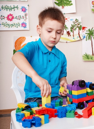 Little boy play construction set at home. photo