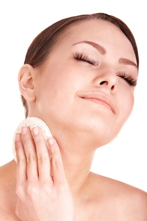 Young woman washing her face by sponge. Isolated. Stock Photo - 9268159