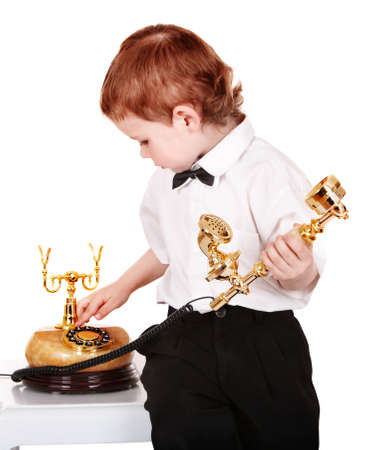 Boy in business suit with telephone. Isolated. Stock Photo - 9268054