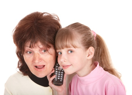 Grandmother and granddaughter call by phone.. Isolated. photo