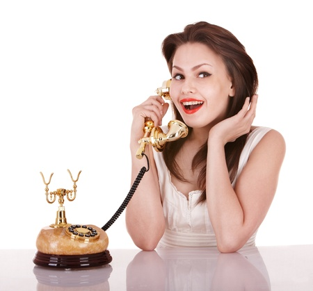 Young beautiful woman talking by phone. Isolated. Stock Photo - 9268066