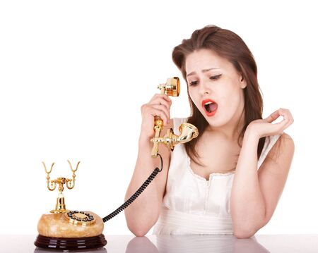 Young beautiful woman talking by  phone. Isolated. Stock Photo - 9268076