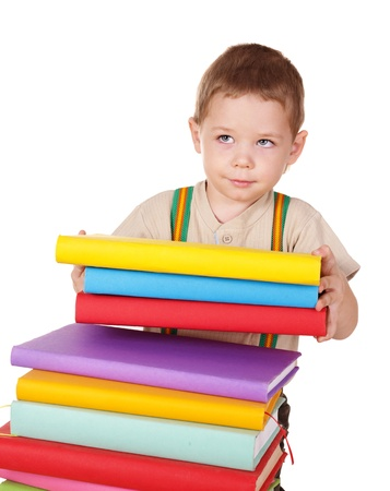 able to learn: Little boy reading pile of books.