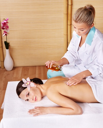 Young woman on massage table in beauty spa.  Series. photo