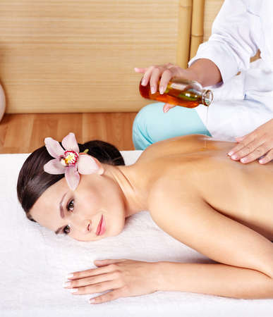 massage table: Young beautiful woman on massage table in beauty spa. Series.