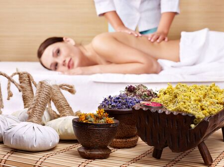 Still life with young beautiful woman on massage table in beauty spa.  Stock Photo