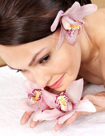 Beautiful young woman having massage. photo