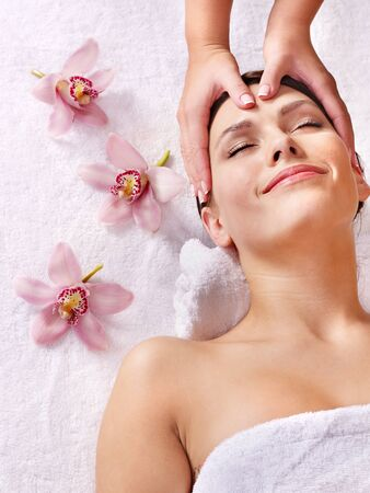 beauty parlour: Beautiful young woman having massage. Stock Photo