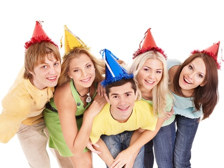 Group of young people in party hat . Isolated. photo