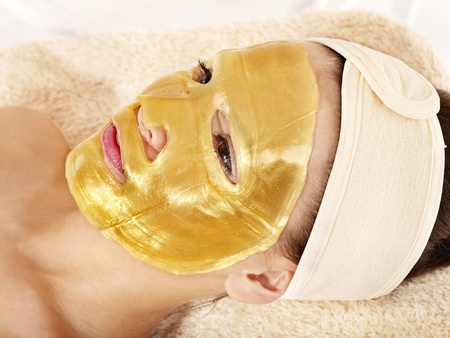 Young womanl with gold facial mask. Stock Photo - 9284388