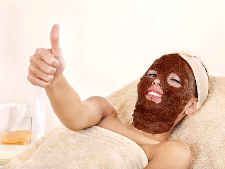 Young womanl with algae facial mask. photo