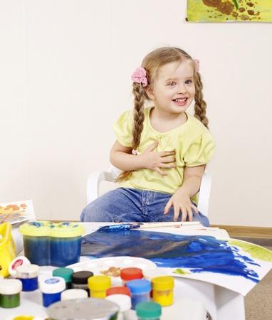 Happy child painting in preschool.  photo