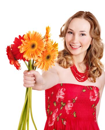 Happy young woman holding red flowers. Stock Photo - 9284328