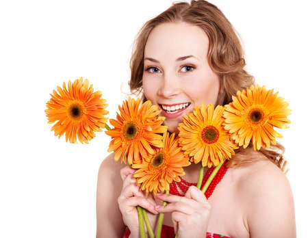 Happy young woman holding red flowers. Stock Photo - 9284340