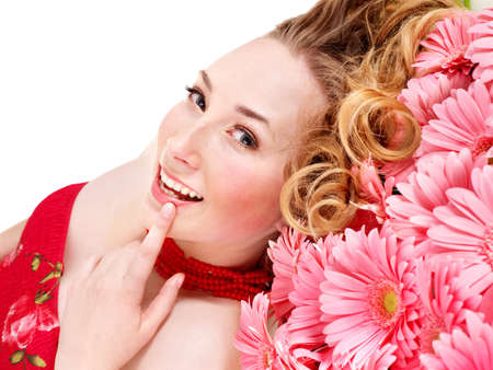 Happy young woman lying on flowers. photo