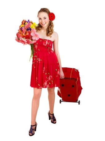 Traveling young woman with wheeled luggage. Isolated. photo
