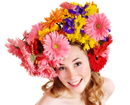 Young woman with flower wreath. Spring hairstyle. photo